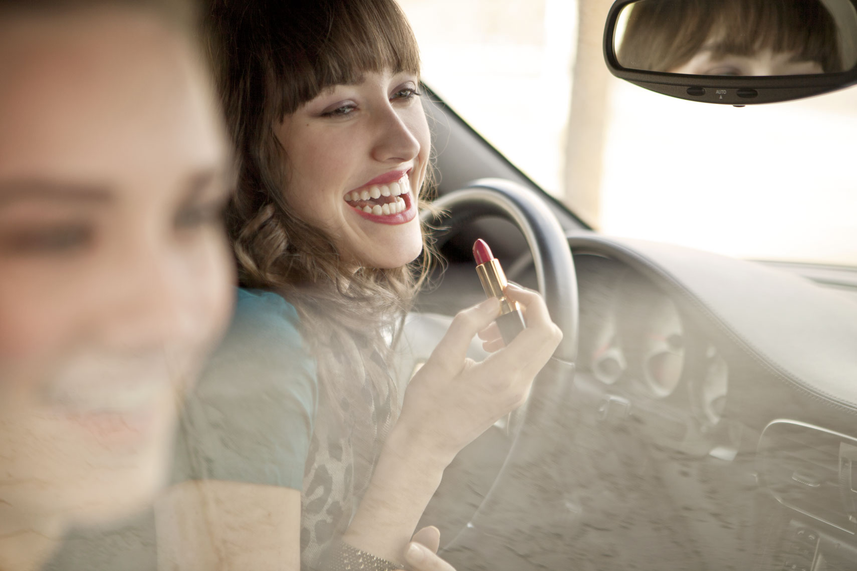 Lifestyle Portrait Of Young Women Friends In Car