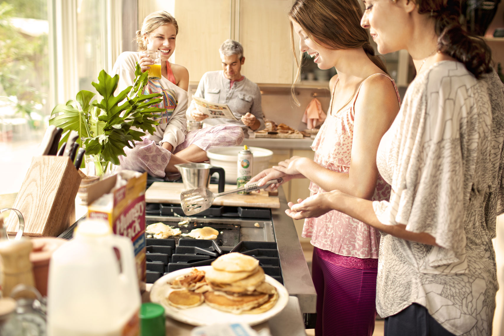Editorial lifestyle photography of a caucasian family making breakfast for commercial print advertising