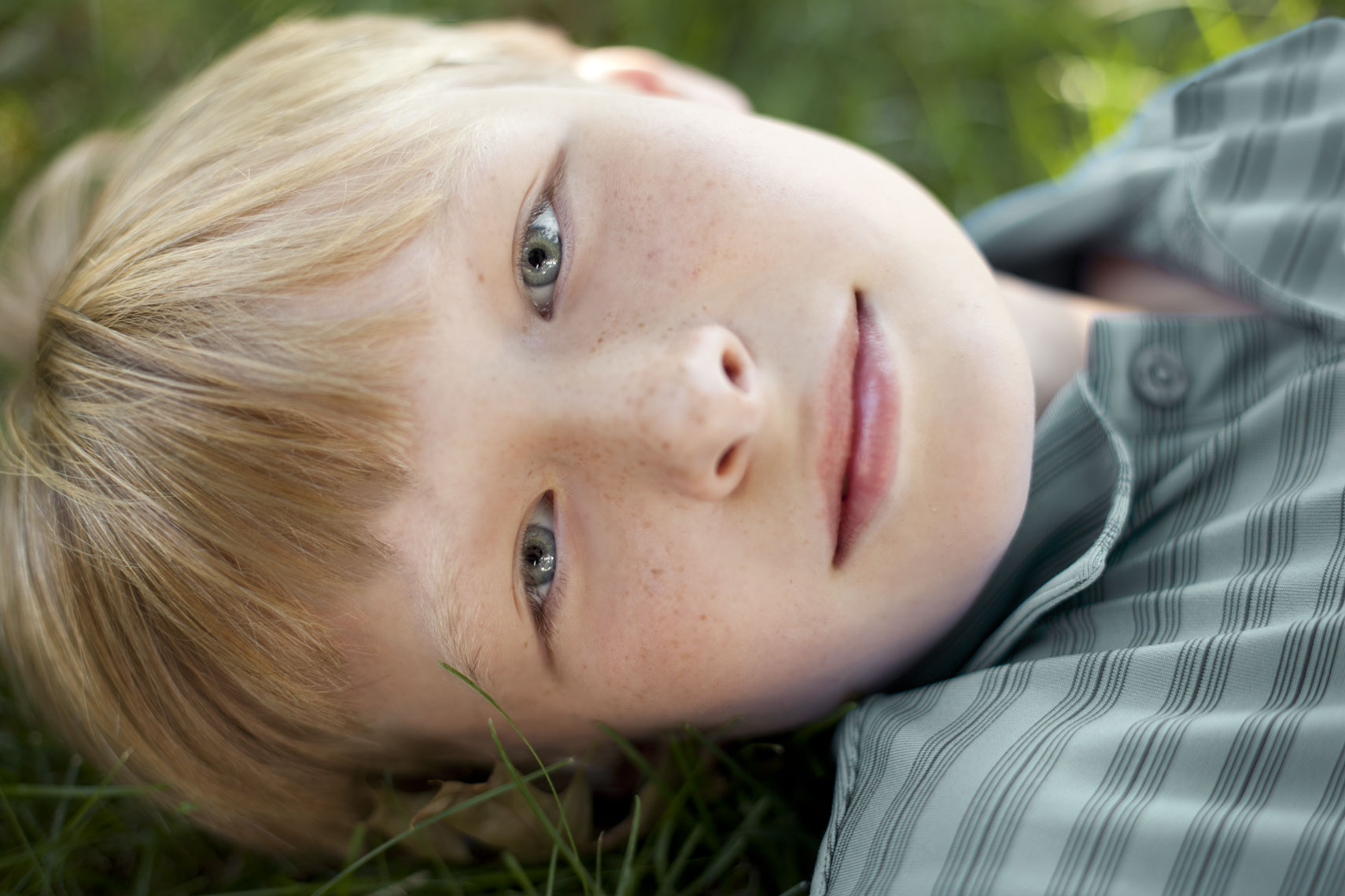 Environmental portrait of a young boy outside