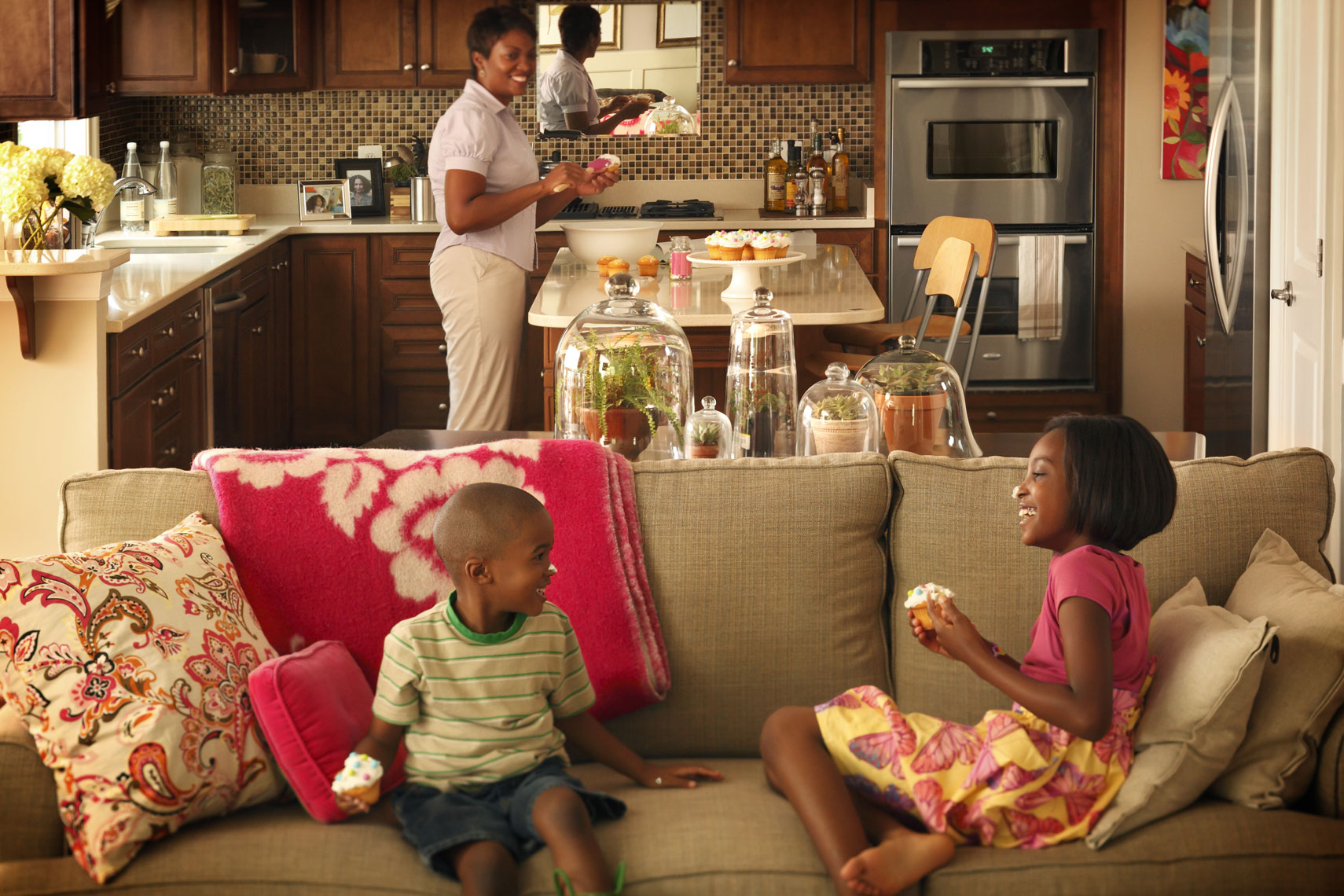 Lifestyle Architectural photography with African American family in kitchen for print advertising