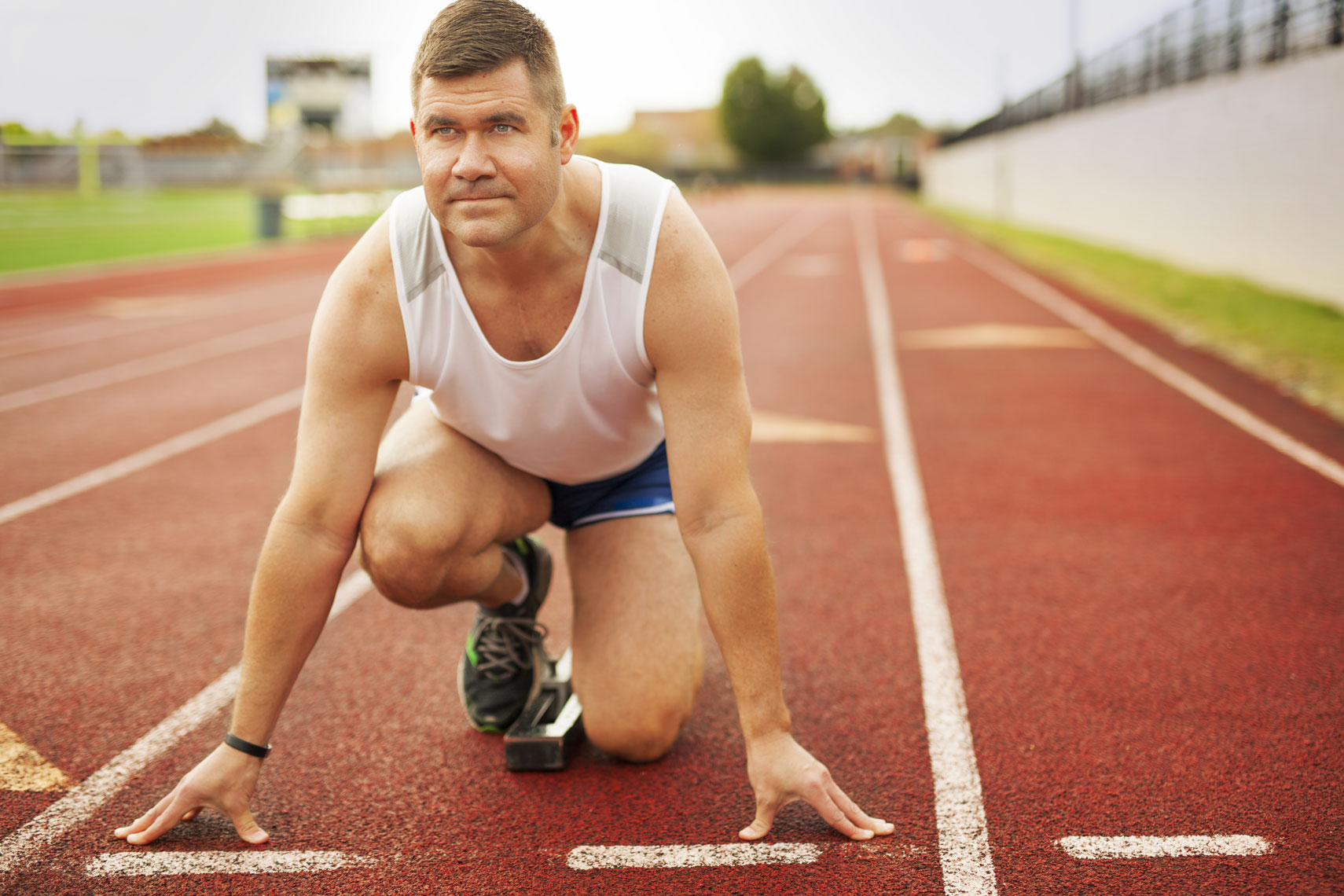 Lifestyle portrait of a man on a track for pharmaceutical advertising