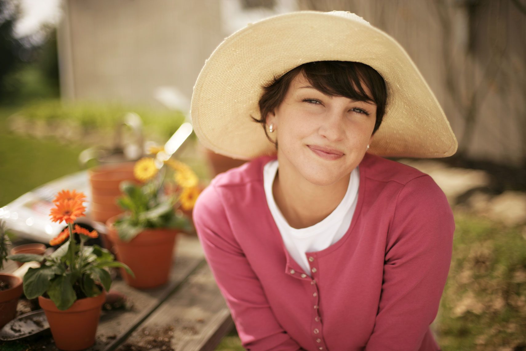 Advertising lifestyle portrait of a woman gardening