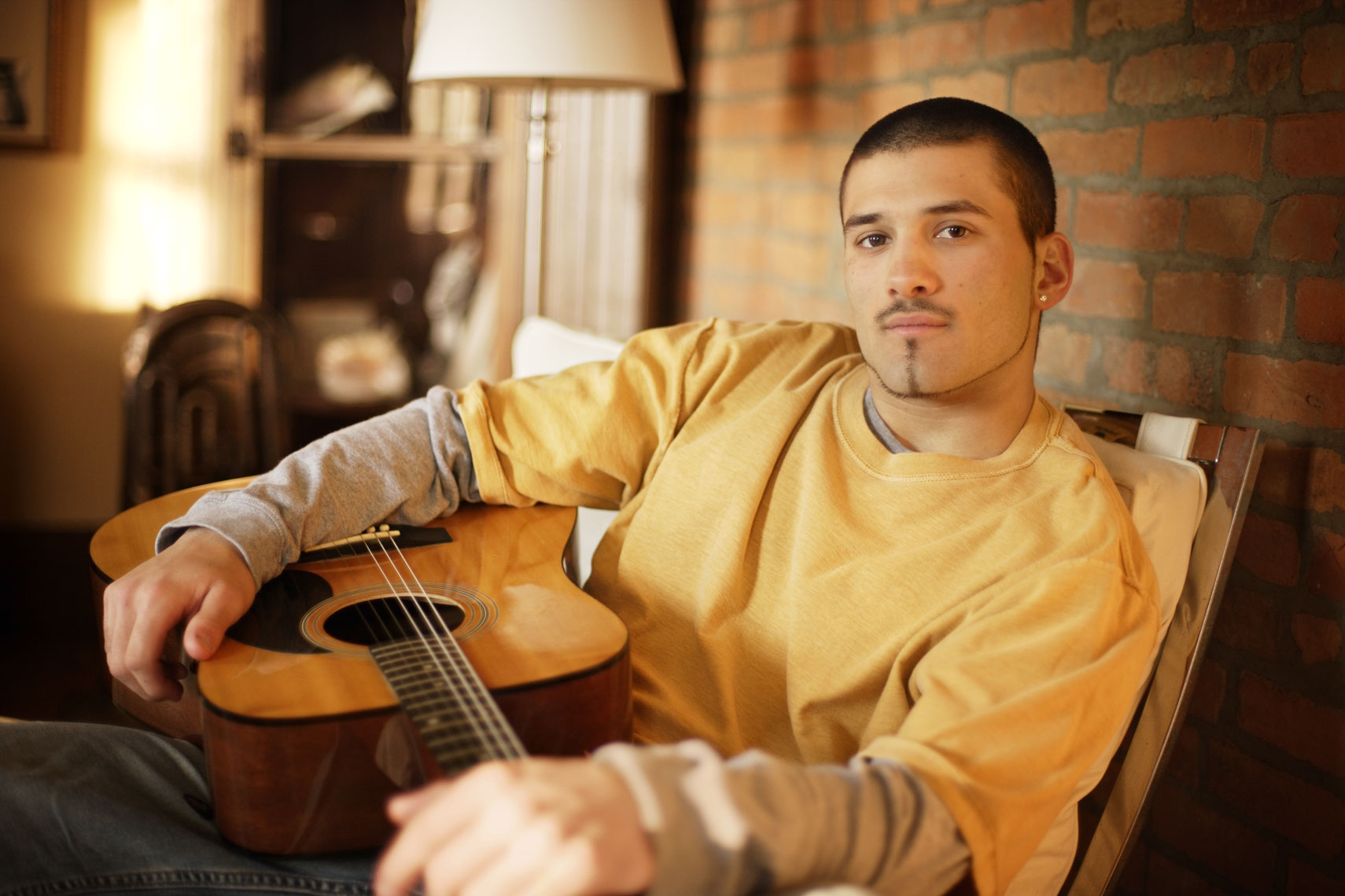 Pharmaceutical advertising portrait of a young man with a guitar