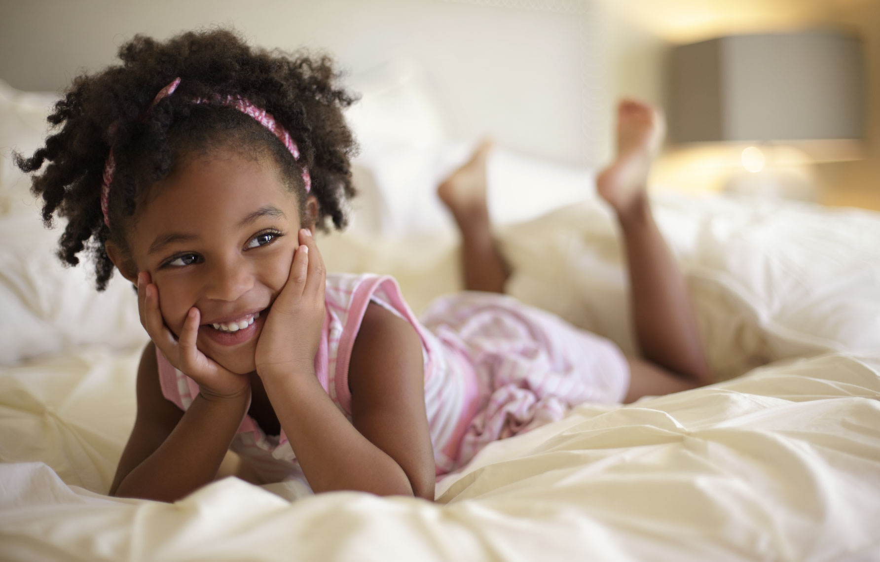 Environmental Portrait Of Young Girl On Bed