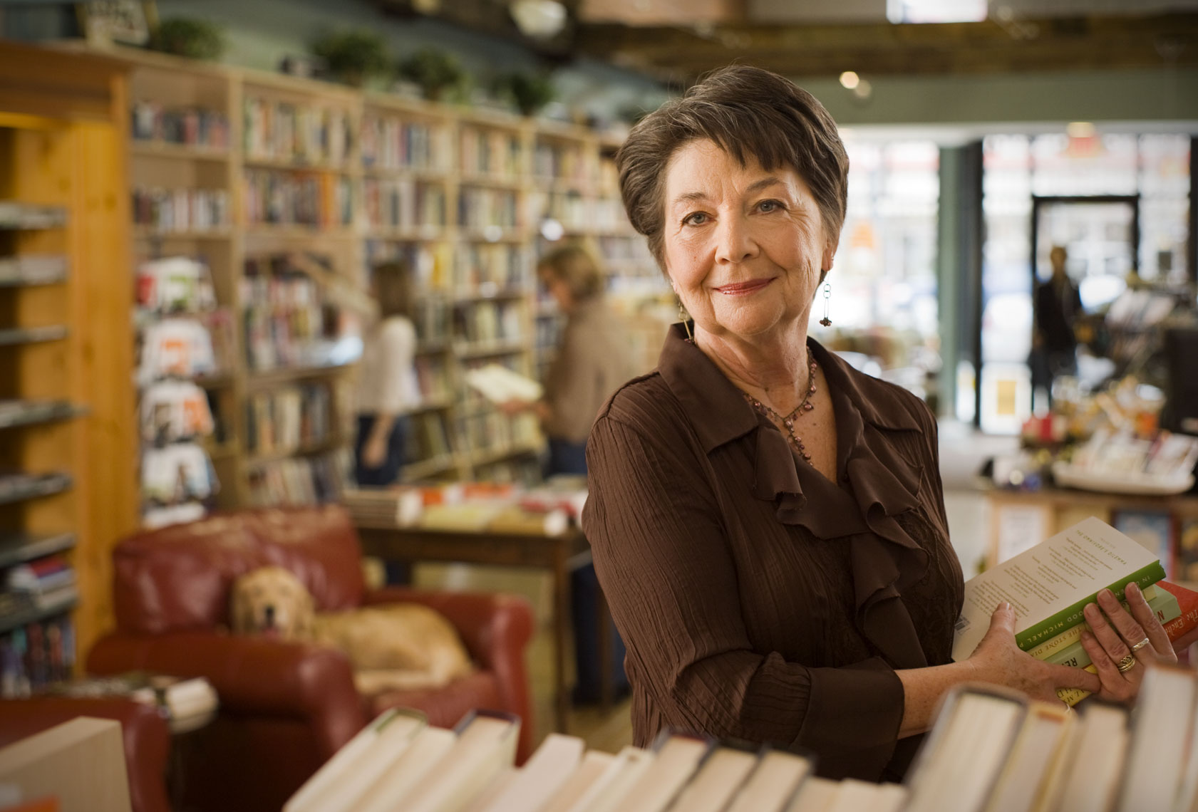 Commercial advertising portrait of a woman working in a  book store