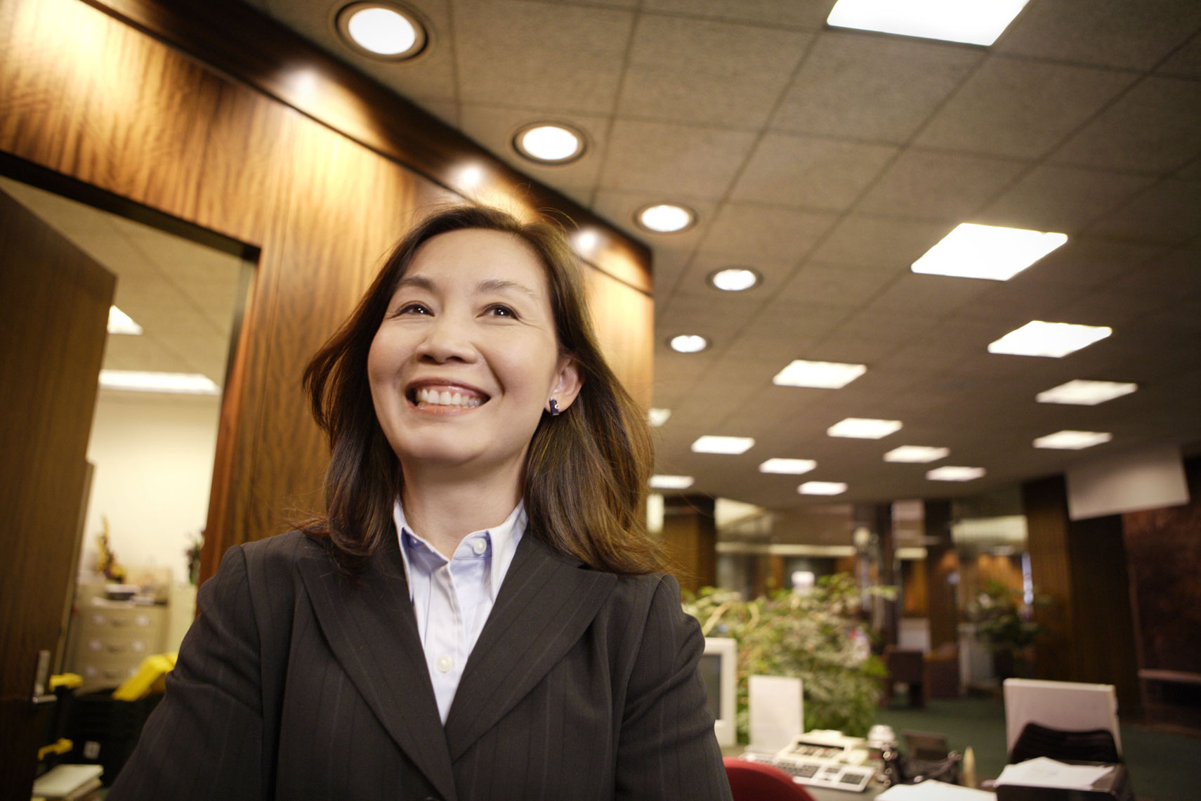 Environmental portrait of an Asian woman bank employee
