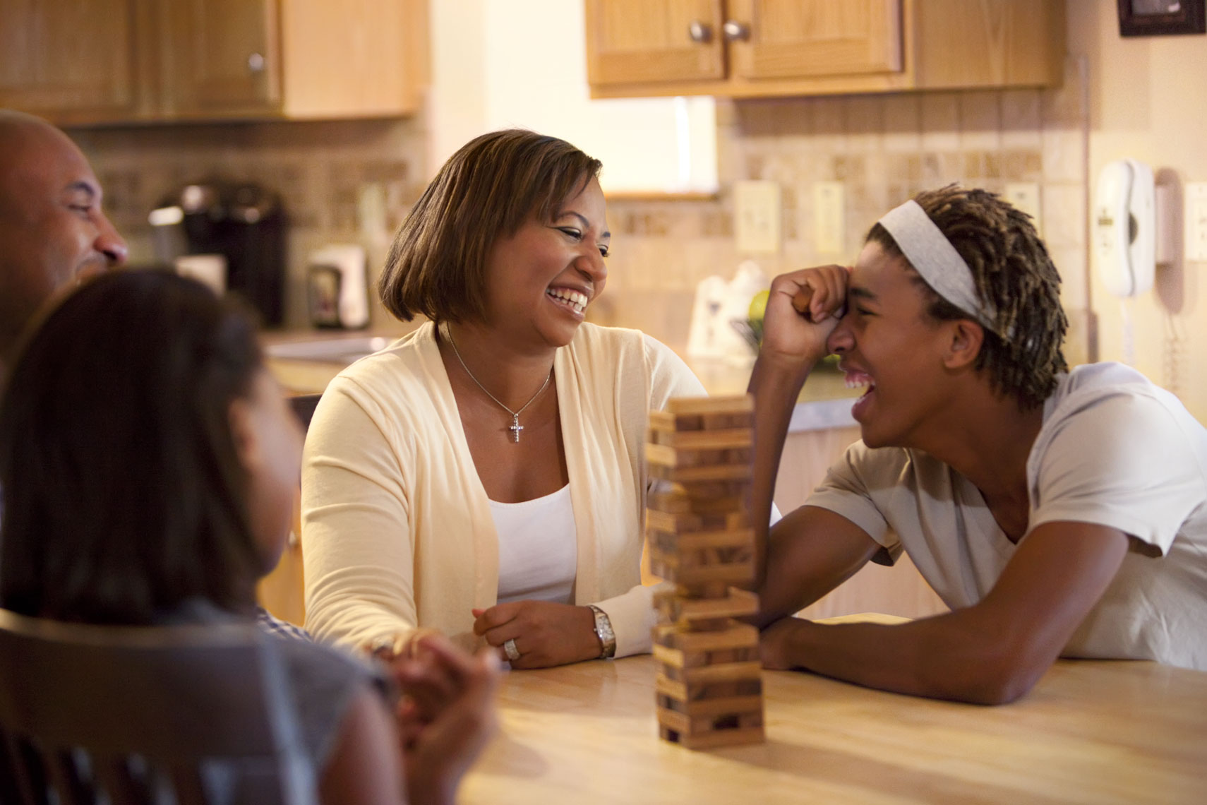 Lifestyle Portrait Of African American Family Playing Game