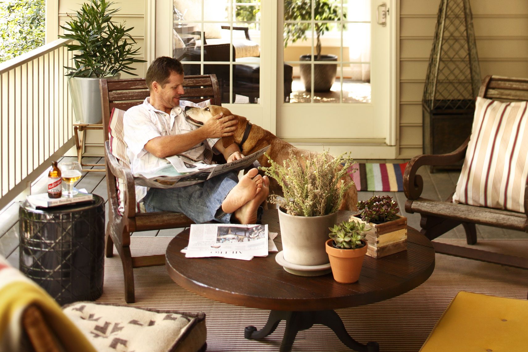 Lifestyle Architecture With Man And Dog On Patio For Home Builder